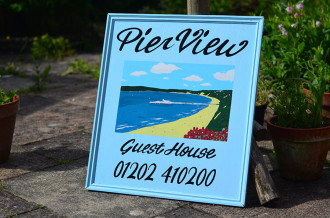 PierView Guesthouse sign