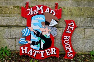 Mad Hatter hanging sign restoration