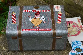 Handpainted logo on Mr. Barber's barber case
