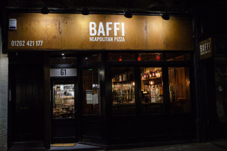 Baffi pizza sign at night