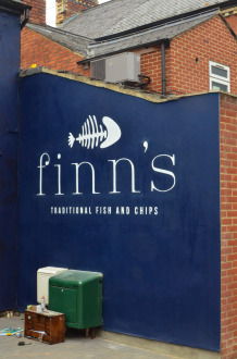 Finn's logo painted on exterior wall