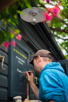 Signwriter at work in Christchurch