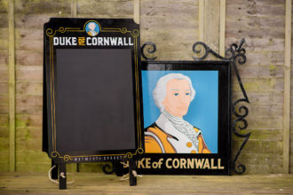 The Duke of Cornwall pub sign and A-board