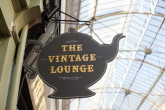 Gold leaf teapot sign for The Vintage Lounge